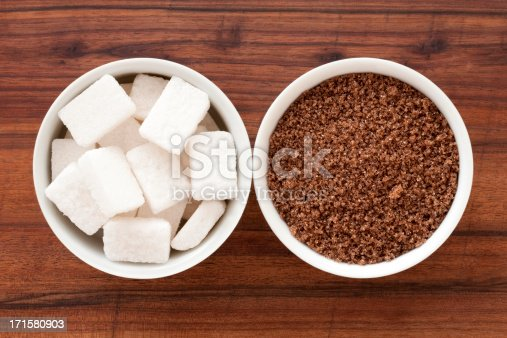 Top view of two bowls containing sugar varieties