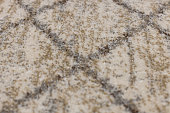 Brown and gray background with cross, fleecy carpet texture. Focus with shallow depth of field.
