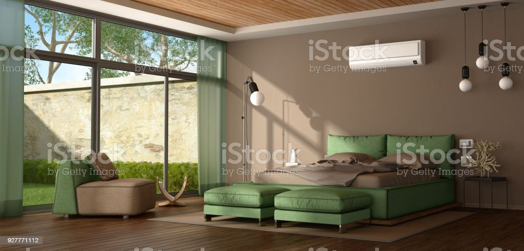 Brown and green modern master bedroom - foto stock