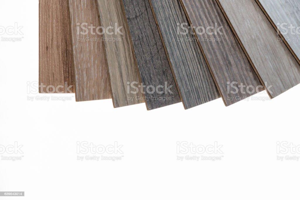 brown and grey laminate flooring samples - foto de acervo