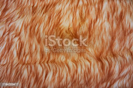 Brown and white colored Fluffy Background.Shaggy fur texture. Fur skins for sheepskin skins for interior design