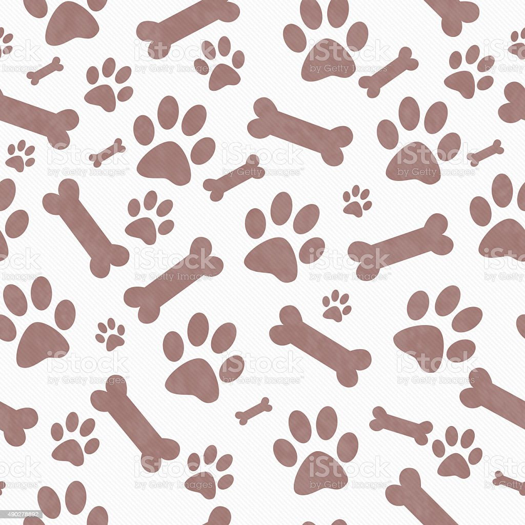 Brown  and White Dog Paw Prints and Bones Repeat Background stock photo