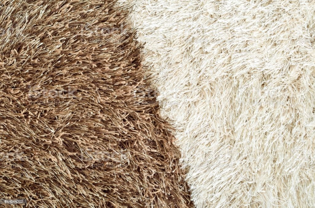 Brown and white hairy carpets divide in half stock photo