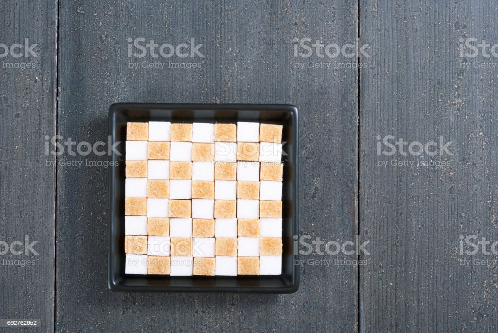 Brown and white sugar cubes stock photo