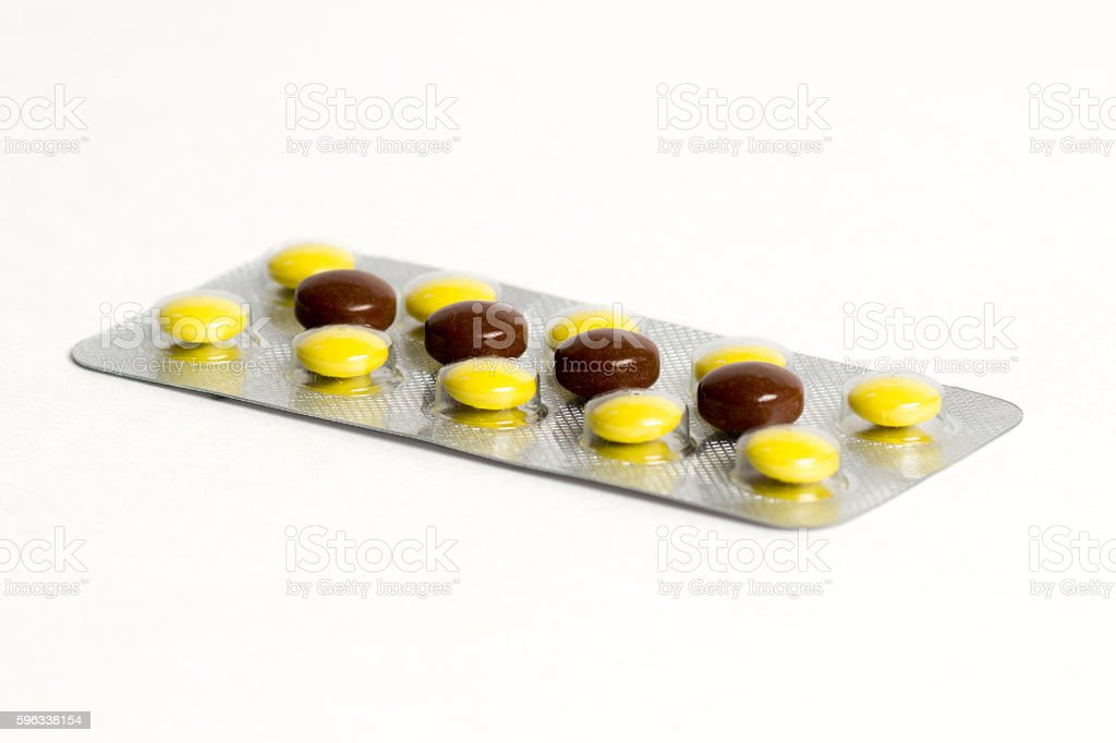 brown and yellow antibiotic in blister Lizenzfreies stock-foto