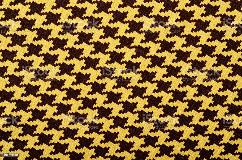 Brown and yellow houndstooth pattern. stock photo