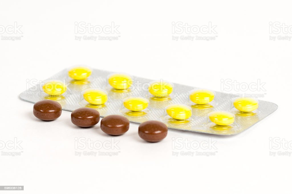 brown and yellow pills in blister Lizenzfreies stock-foto