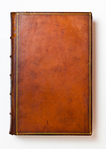 Brown Antique Leather Book Cover Rich brown leather book cover that's over 200 years old. Only centuries of age can produce such a rich patina and lovely wear. hardcover book stock pictures, royalty-free photos & images