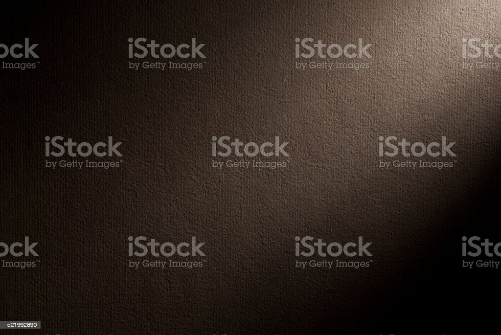 Brown background illuminated from the right corner stock photo