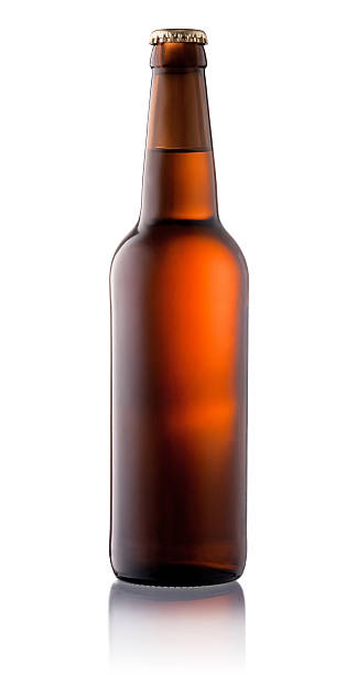brown beer bottle isolated on white background - dark beer stock photos and pictures