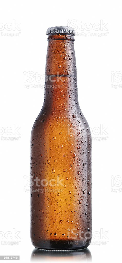 Brown beer bottle with drops royalty-free stock photo