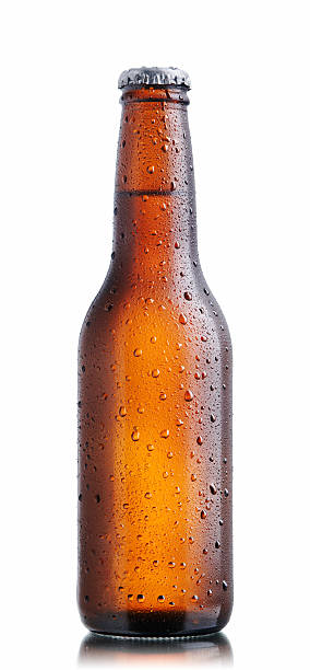 Brown beer bottle with drops stock photo