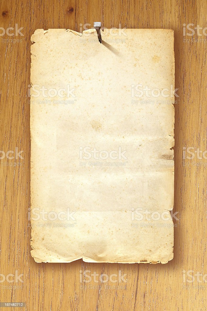 Brown blank Wanted poster fixed with nail on wooden background stock photo