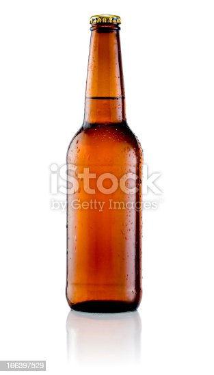 Brown bottle of beer with drops on a white background