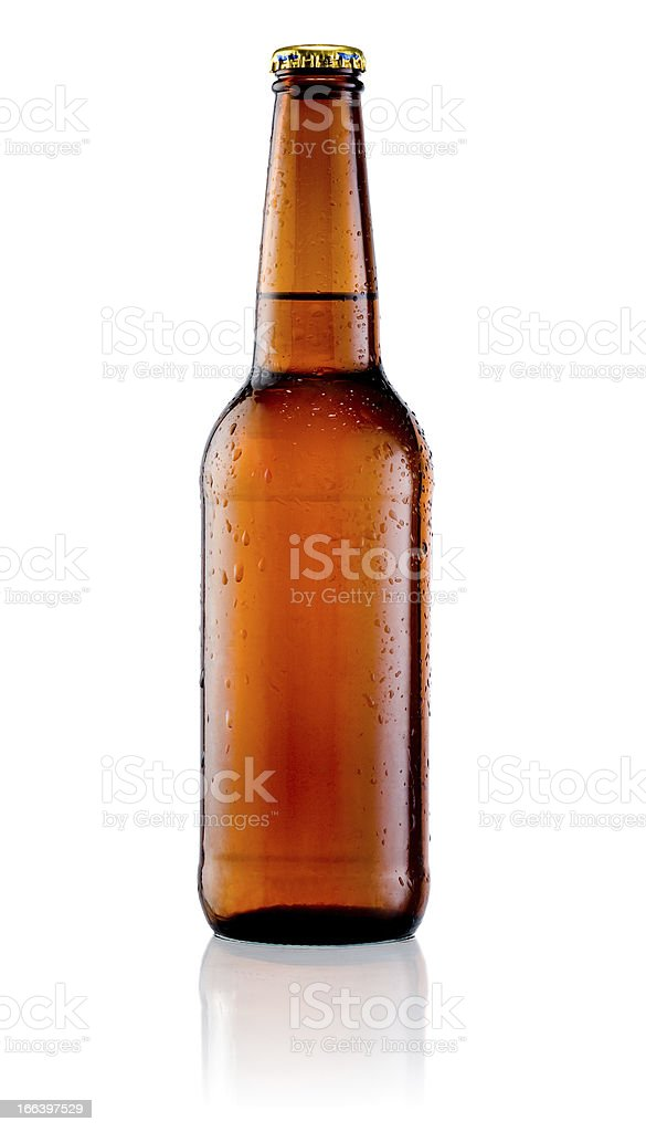 Brown bottle of beer with drops on a white background stock photo