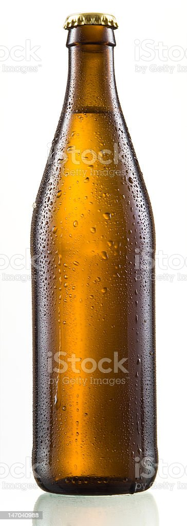 Brown bottle of beer with reflection stock photo