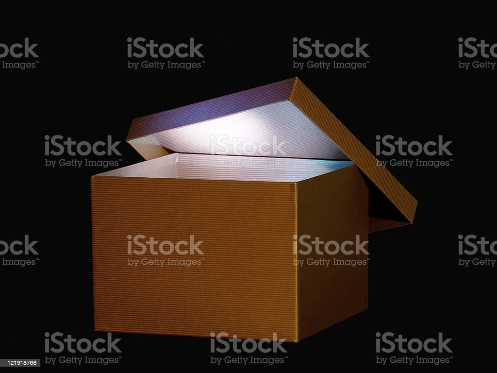 Brown box with soft glowing light inside stock photo