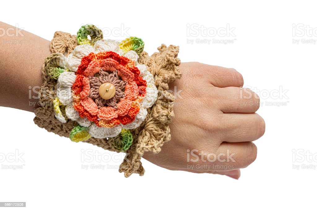 Brown bracelet embroidered with threads stock photo