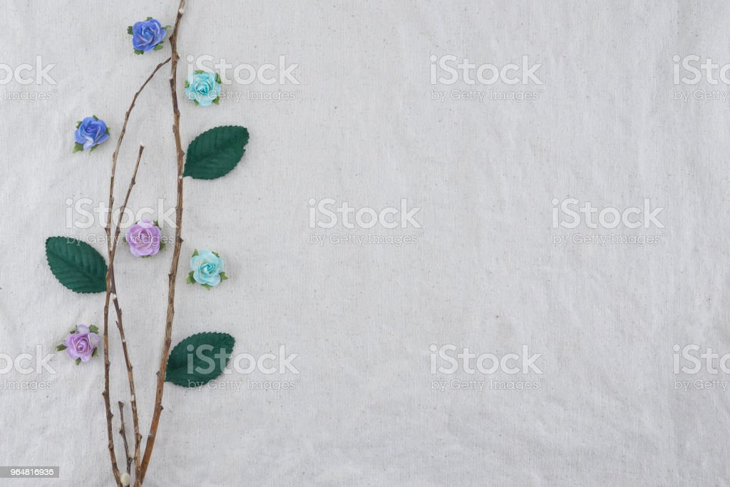 Brown branch decorate with blue tone rose paper flowers royalty-free stock photo