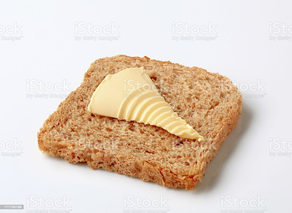 Brown bread and butter royalty-free stock photo
