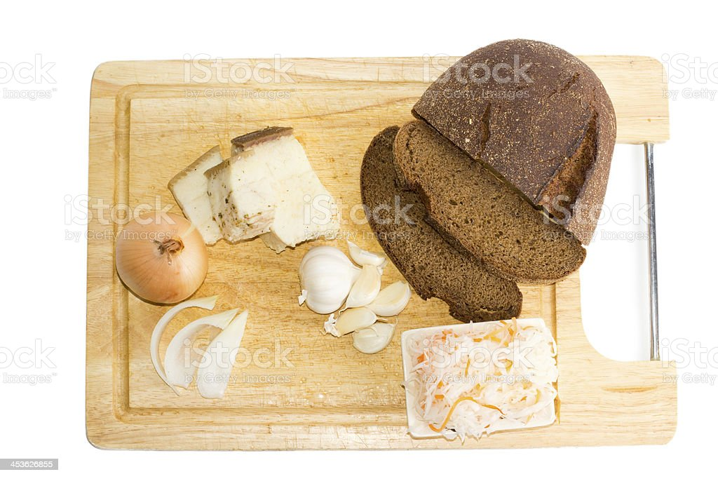 Brown bread and salad on wooden tray royalty-free stock photo