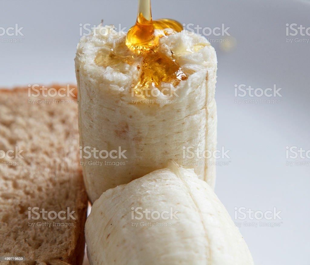 Brown bread banana and honey stock photo