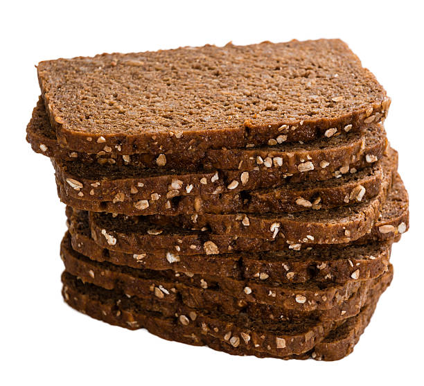 marrón pan aislado sobre blanco - pan multicereales fotografías e imágenes de stock