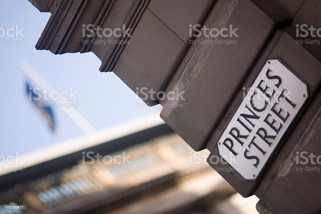Brown brick on Princes Street in Edinburgh with flag flying stock photo
