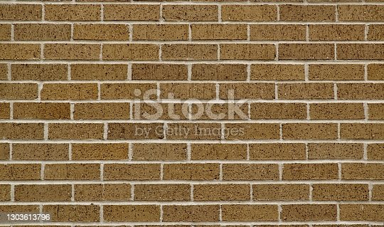 Brown brick surrounding wall section, color swatch sample. Plain earth tones full frame image.