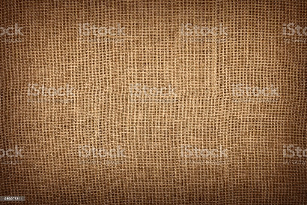 Brown burlap jute canvas background with shade stock photo