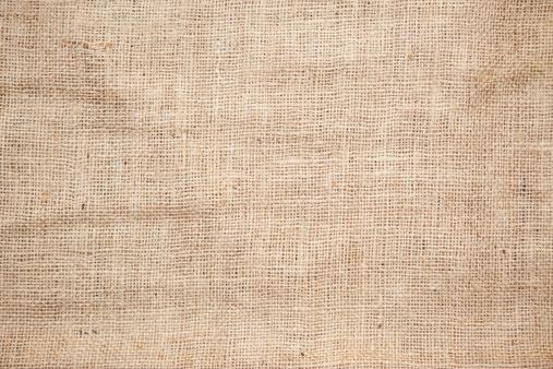 Color photo of the texture of a brown burlap potato sack.