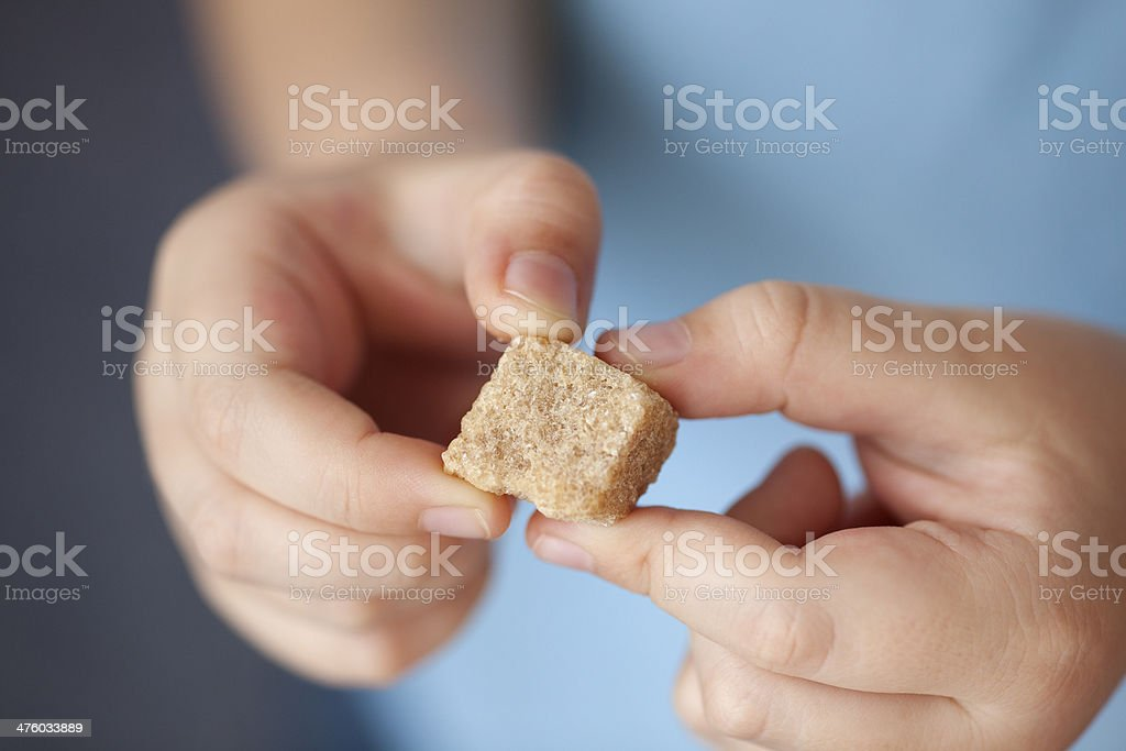Brown cane sugar in child's hands royalty-free stock photo