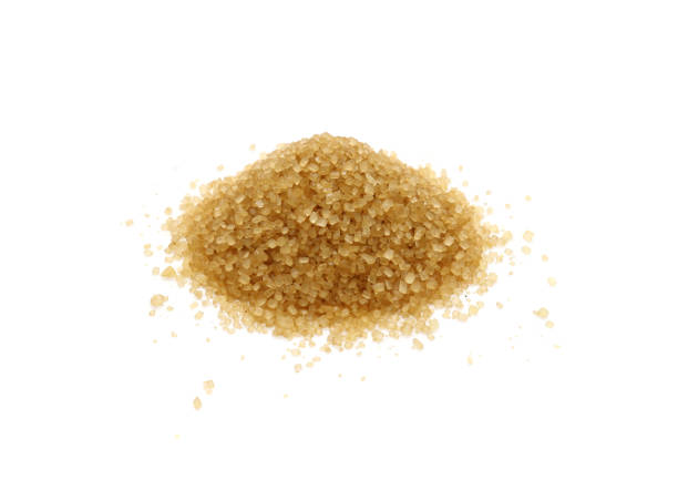 Brown cane sugar pile isolated on white. Brown cane sugar pile isolated on white background. sugar cane stock pictures, royalty-free photos & images