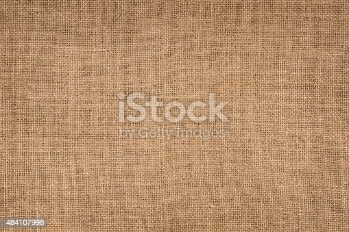 Natural linen striped, coloured, and textured sacking burlap background.