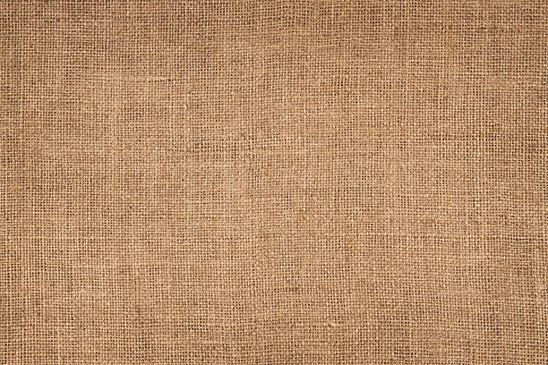 Brown Canvas Background Natural linen striped, coloured, and textured sacking burlap background. burlap stock pictures, royalty-free photos & images
