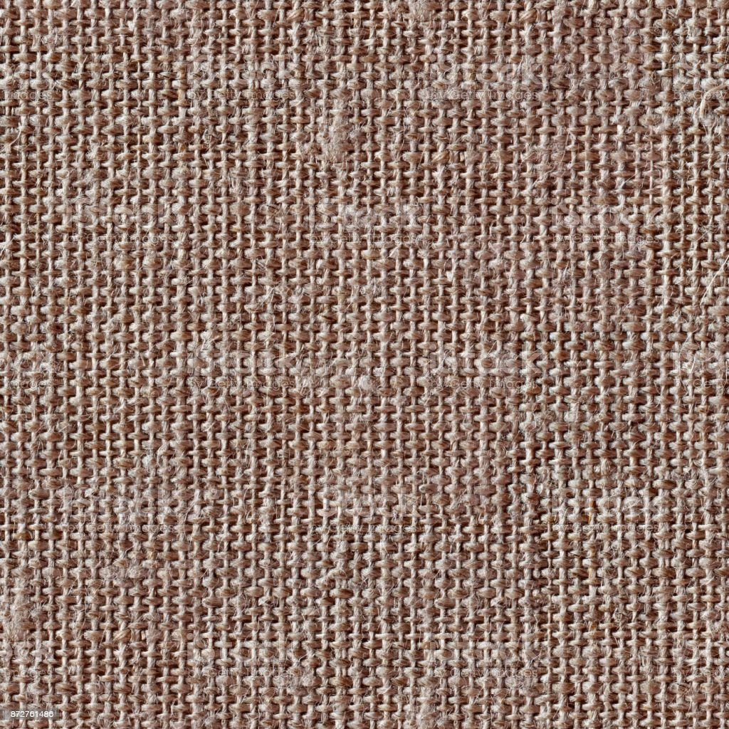 Brown canvas texture or background. Seamless square texture. Til stock photo