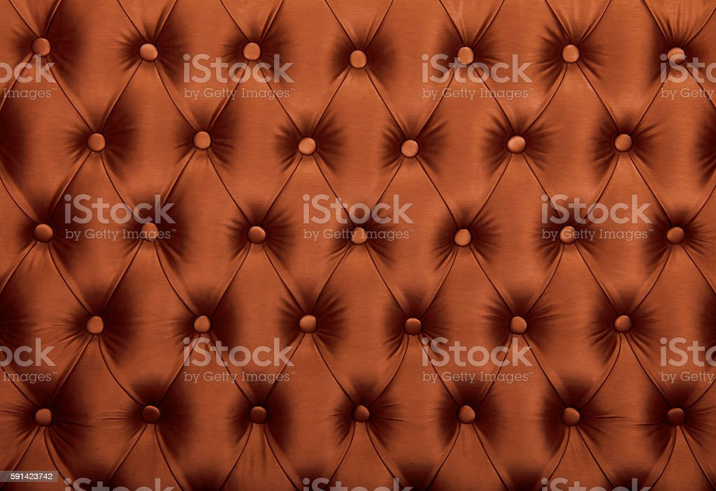 Brown capitone tufted fabric upholstery texture stock photo