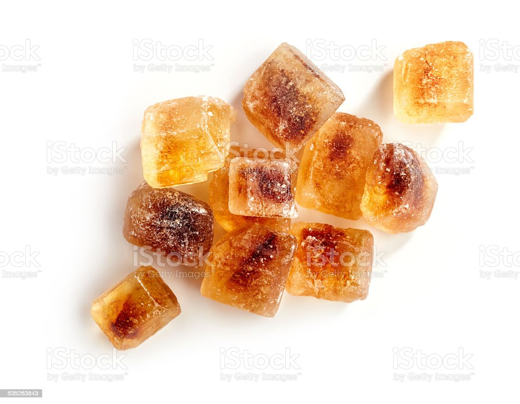 Brown caramelized sugar cubes on a white background stock photo