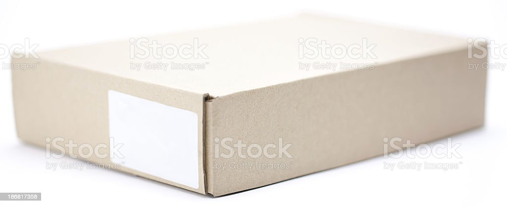 Brown card board box with blank label royalty-free stock photo