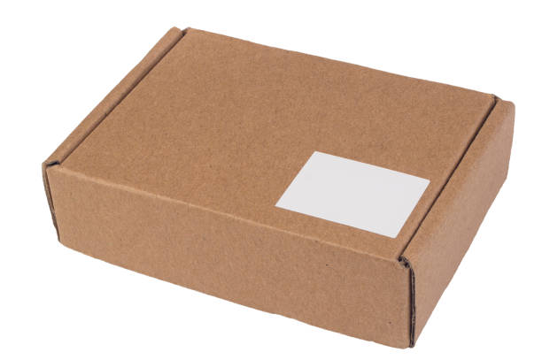 Brown cardboard box closed with a sticker label. Isolate on a white background. Delivery, packaging concept stock photo