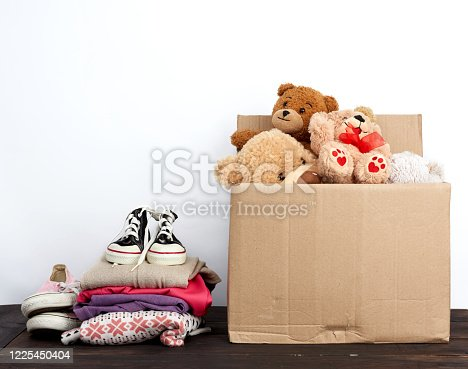 istock brown cardboard box filled with things and children's toys 1225450404