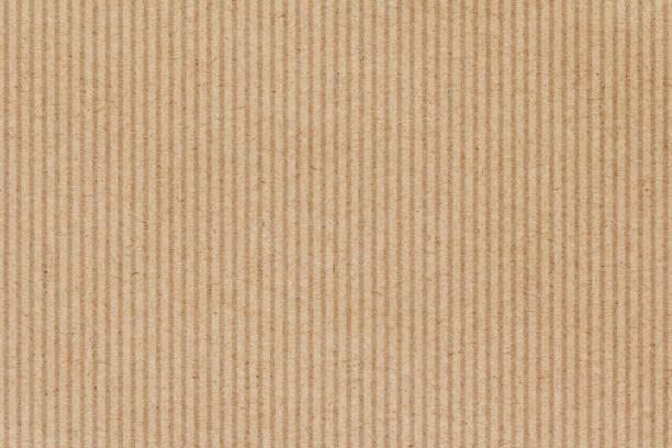 bruin karton papier textuur achtergrond - bordpapier stockfoto's en -beelden