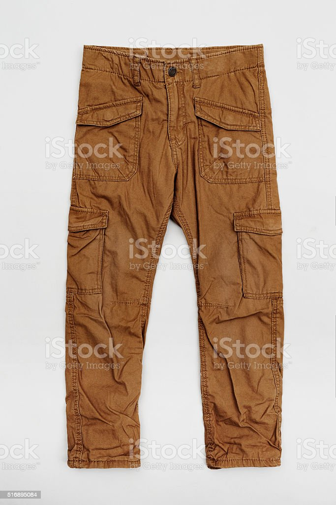 Brown cargo pants in white studio stock photo