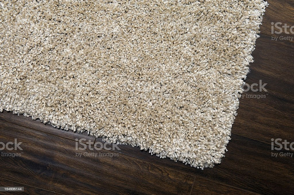 A brown carpet on a wooden floor royalty-free stock photo