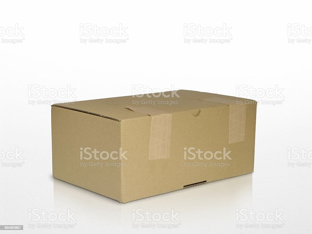 brown carton box isolated on white with reflection royalty-free stock photo