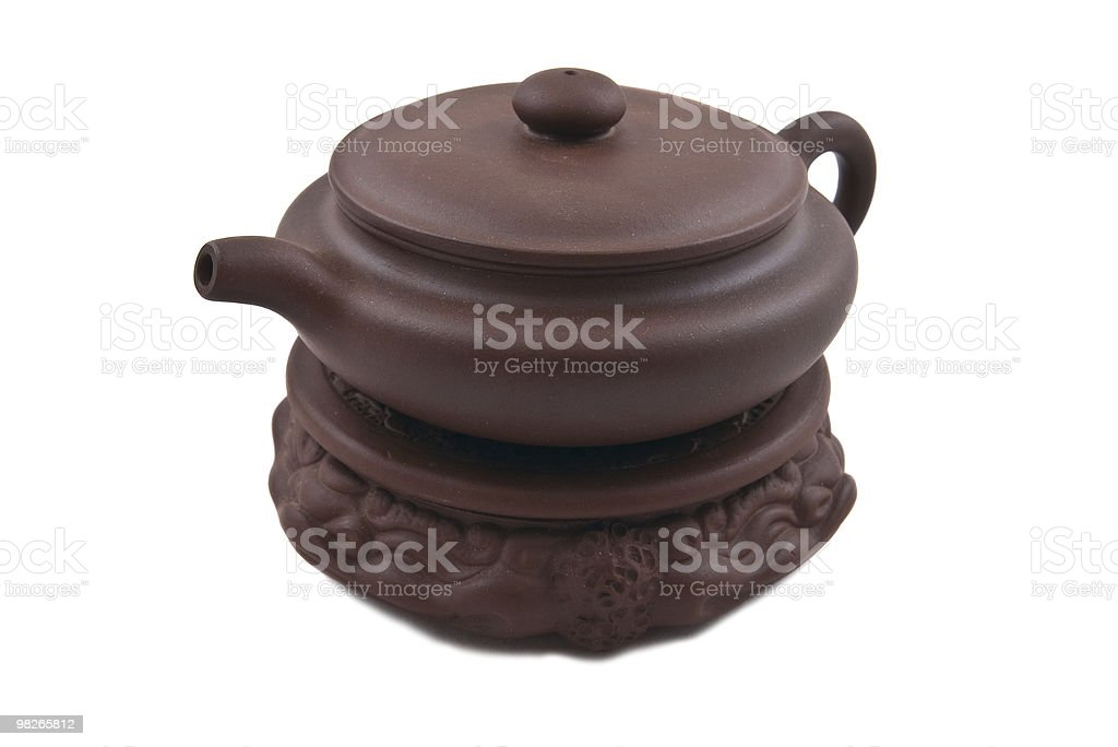 brown ceramic teapot for traditional tea ceremony on stand royalty-free stock photo