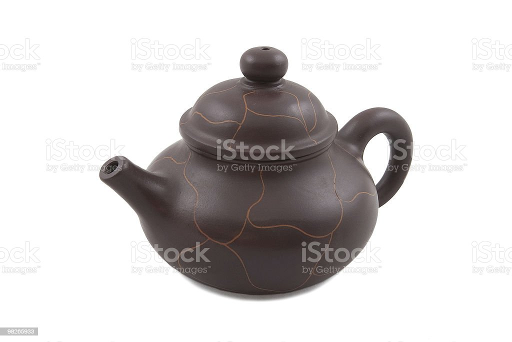 brown ceramic teapot with abstract ornament royalty-free stock photo