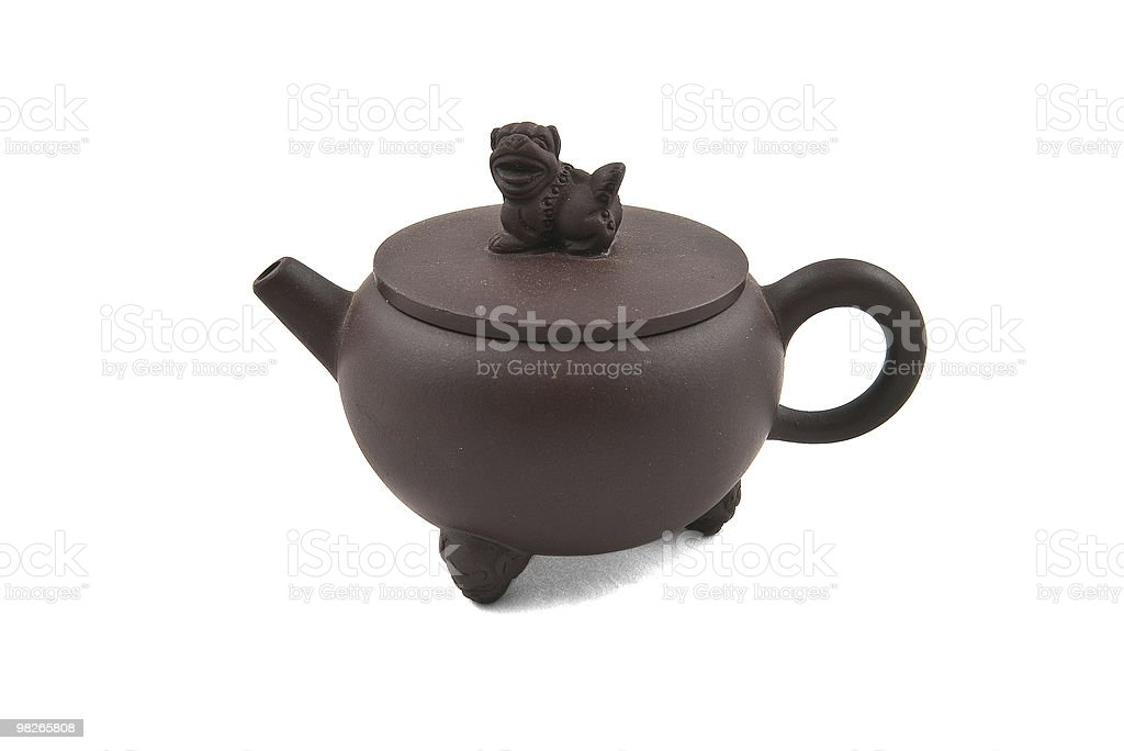 brown ceramic teapot with cover royalty-free stock photo