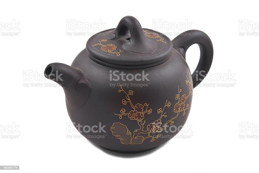 brown ceramic teapot with golden floral ornament royalty-free stock photo