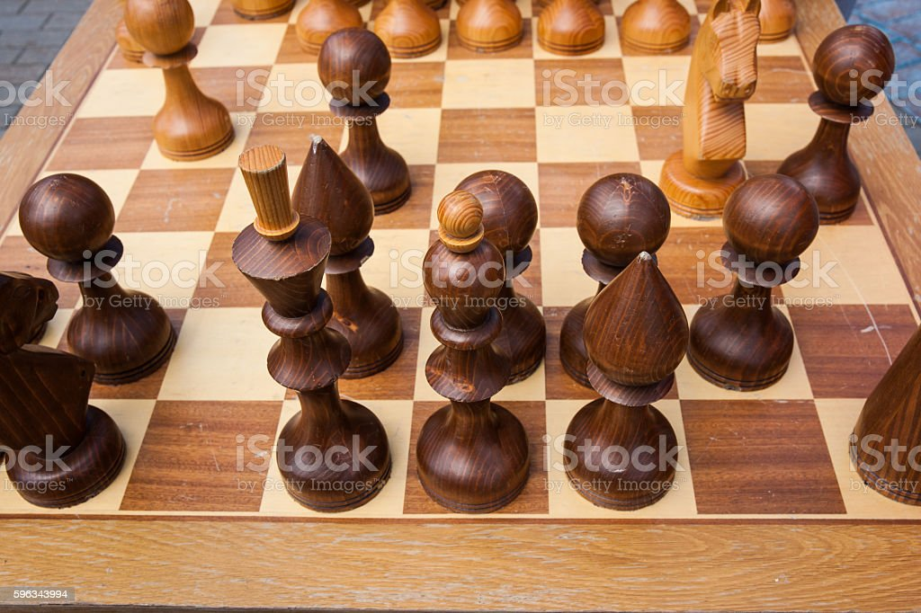 Brown chess pieces on a chess board royalty-free stock photo